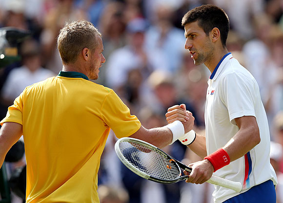 Novak Djokovic (right) of Serbia greets Lleyton Hewitt of Australia after defeating him in the third round match on Wednesday