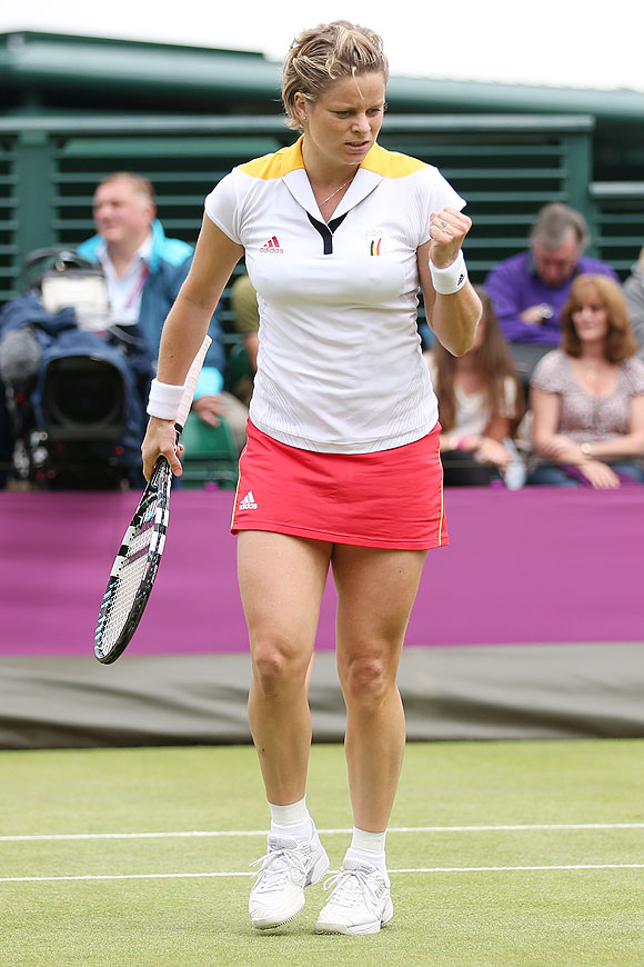 Kim Clijsters celebrates winning a point in her third round match against Ana Ivanovic of Serbia on Wednesday