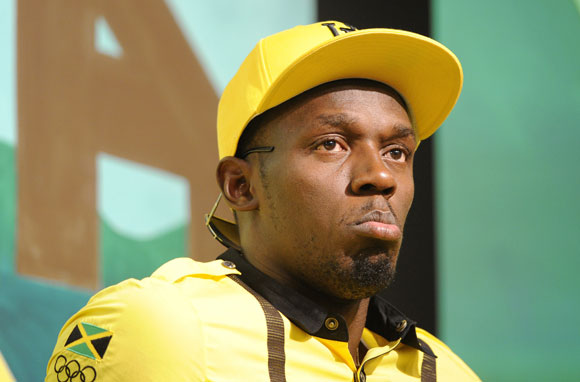Jamaican sprinter Usain Bolt looks on during a team news conference in east London