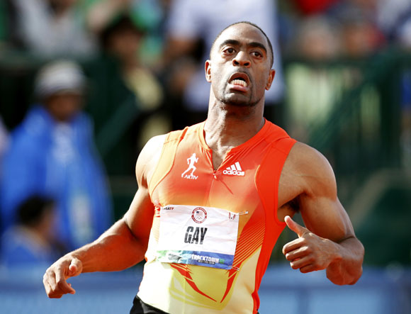 U.S. runner Tyson Gay crosses the finish line in the men's 100 meter dash during the U.S. Olympic Athletic Trials in Eugene