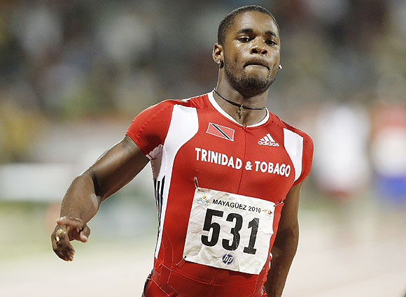 Trinidad and Tobago's Keston Bledman crosses the finish line to win the men 4x100 relay final at the Central American and Caribbean games in Mayaguez