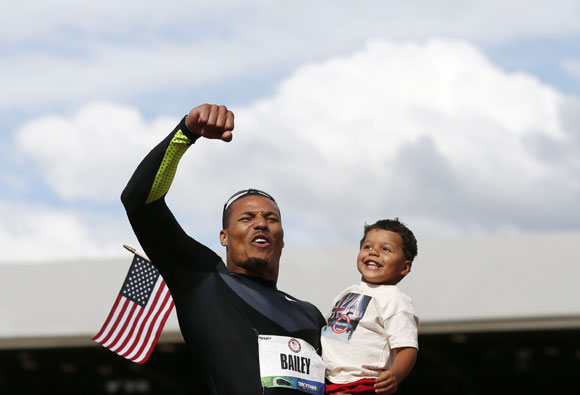 Ryan Bailey celebrates with his son Tyree after coming third in the men's 100 meter final at the U.S. Olympic athletics trials in Eugene