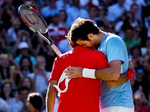 Federer is congratulated by Del Potro after the eipc match