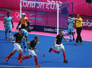 Florian Fuchs (extreme right) celebrates after scoring against India
