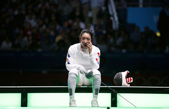 South Korea's Shin A Lam reacts after being defeated by Germany's Britta Heidemann (not seen) during their women's epee individual semifinal fencing competition
