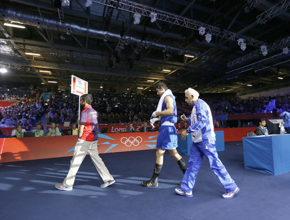 Iran's Ali Mazaheri (2nd L) leaves the ring after being disqualified during his Men's Heavy (91kg) Round of 16 boxing match against Jose Larduet Gomez of Cuba
