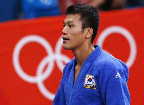 South Korea's Cho Jun-Ho reacts after losing to Japan's Masashi Ebinuma in their men's -66kg quarter-final judo match