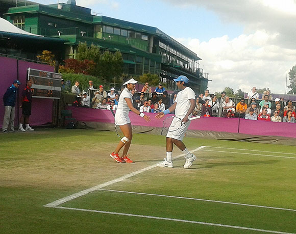 Leander Paes and Sania Mirza in action against Serbian pair of Ana Ivanovic and Nenad Zimonjic on Thursday