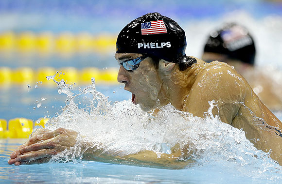United States' Michael Phelps leads compatriot Ryan Lochte during the men's 200-meter individual medley swimming final on Thursday