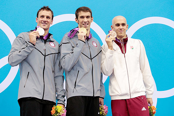 Silver medallist Ryan Lochte of the United States, gold medallist Michael Phelps of the United States and bronze medallist Laszlo Cseh of Hungary pose on the podium during the medal ceremony after the Men's 200m Individual Medley final on Thursday