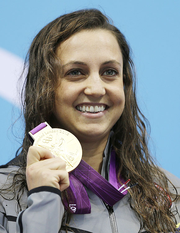 United States' Rebecca Soni poses with her gold medal for the women's 200-meter breaststroke swimming final on Thursday