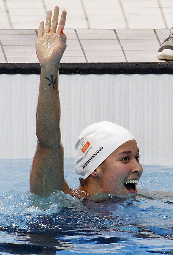 Netherlands' Ranomi Kromowidjojo celebrates winning the women's 100m freestyle final with an Olympic record on Thursday