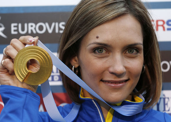 Gold medallist Olha Saladuha of Ukraine poses after the women's triple jump final at the European Athletics Championships in Helsinki