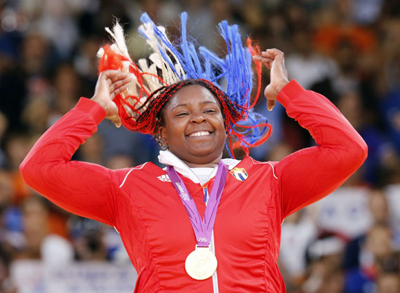 Gold medallist Cuba's Idalys Ortiz jumps at the victory ceremony for the women's +78kg judo event