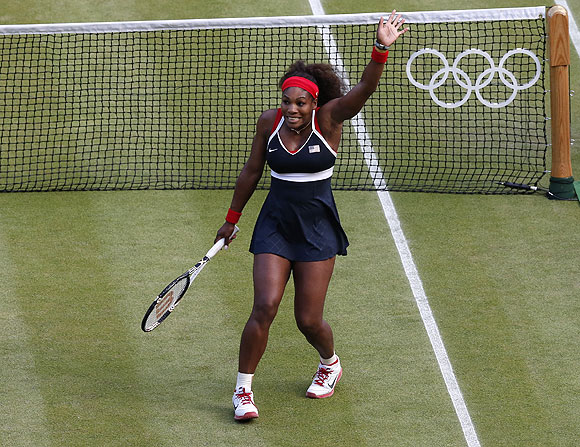 Serena Williams of the US celebrates after defeating Belarus' Victoria Azarenka in their women's singles tennis semi-final match on Friday
