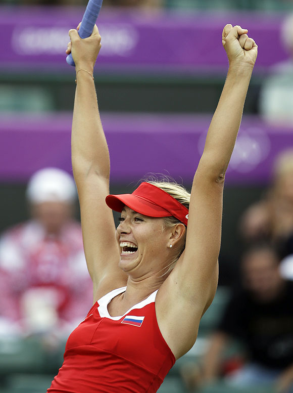 Maria Sharapova of Russia celebrates her win over compatriot Maria Kirilenko