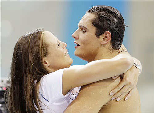 France's Florent Manaudou is embraced by his sister Laure after winning