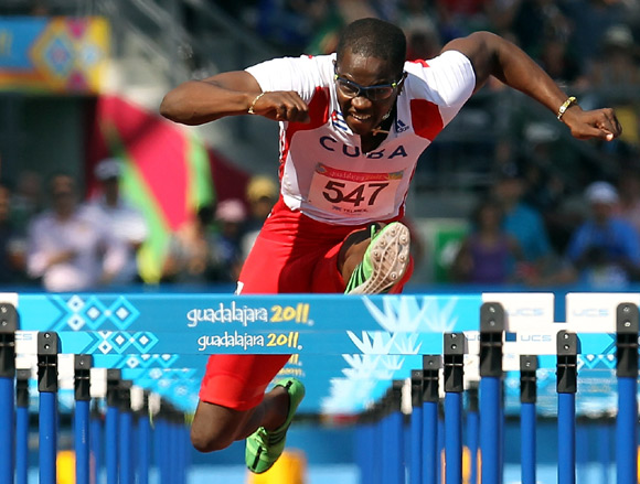 Dayron Robles of Cuba competes in the men's 110m hurdles final during Day 14 of the XVI Pan American Games