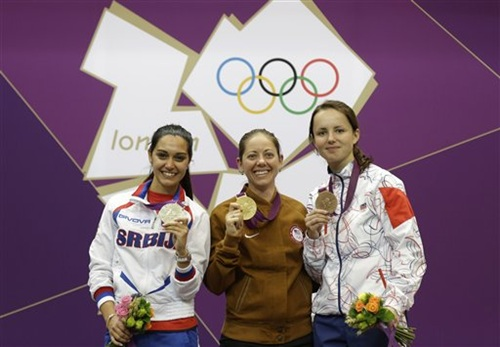 America's Jamie Lynn Gray, centre, poses for a picture with silver medalist Ivana Maksimovic of Serbia, left, and bronze medalist Adela Sykorova of Czech Republic