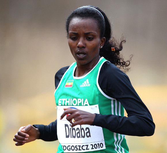 Tirunesh Dibaba of Ethiopia on her way to fourth position in the Senior Women's race during the Iaaf World Cross Country Championships