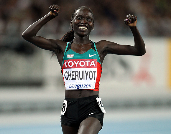 Vivian Jepkemoi Cheruiyot of Kenya celebrates as she crosses the finish line to win the women's 10,000 metres final during day one of the 13th IAAF World Athletics Championships at the Daegu Stadium