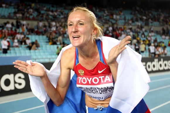 Yuliya Zaripova of Russia celebrates claiming gold in the women's 3000 metres steeplechase final during day four of the 13th IAAF World Athletics Championships at the Daegu Stadium
