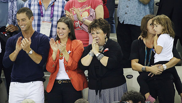 Debbie Phelps, center, the mother of United States' Michael Phelps
