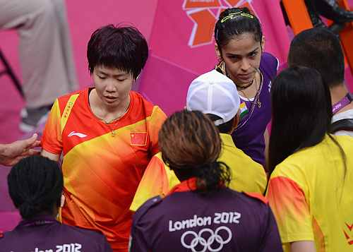 Xin Wang of China is helped from the court after sustaining an injury forcing her to retire from her Women's Singles Badminton Bronze Medal match
