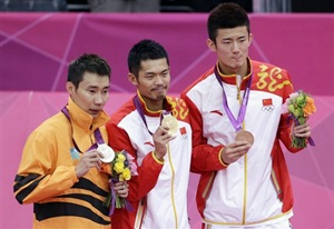 Gold medalist Lin Dan (centre), silver medalist Lee Chong Wei (left) and bronze medalist Chen Long