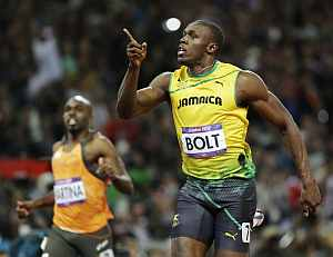 Usain Bolt celebrates after crossing the finish