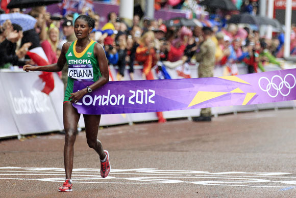 Ethiopia's Tiki Gelana crosses the finishing line as she wins the women's marathon final