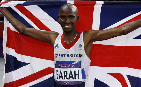 Britain's Mo Farah holds the Union Flag after winning the men's 10,000m final