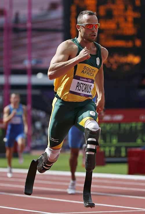 South Africa's Oscar Pistorius competes in a men's 400-meter heat during the athletics in the Olympic Stadium