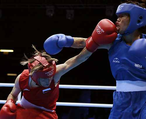 Poland's Karolina Michalczuk, left, fights India's Mary Kom during the women's flyweight boxing competition
