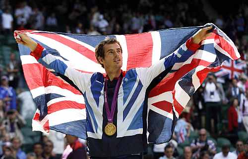 Gold medalist Andy Murray of Great Britain waves the British flag during the medal ceremony of the men's singles event at the All England Lawn Tennis Club