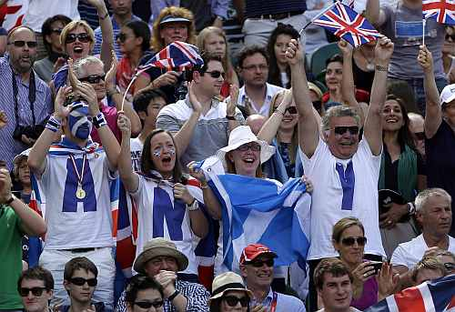 Fans of Andy Murray of Great Britain cheer during his match against Roger Federer of Switzerland during the gold medal men's singles