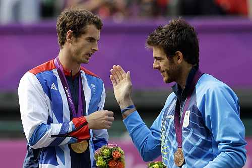 Gold medalist Andy Murray of Great Britain, left, shakes hands with bronze medalist Juan Martin del Potro of Argentina, right, during the medal ceremony of the men's singles event