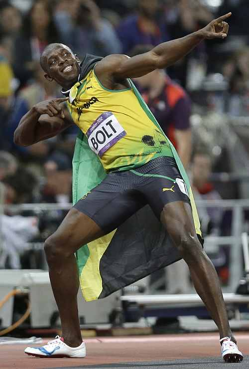 Jamaica's Usain Bolt celebrates after winning the men's 100-metre final
