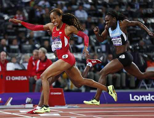 United States' Sanya Richards-Ross, front left, crosses the finish line to win gold in the women's 400-meter final