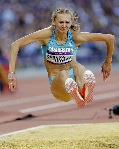 Kazakhstan's Olga Rypakova competes to win gold in the women's triple jump final