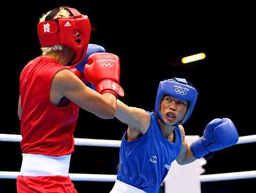 Mary Kom of India competes against Maroua Rahali (Red) of Tunisia during the Women's Fly (51kg) Boxing quarter-finals