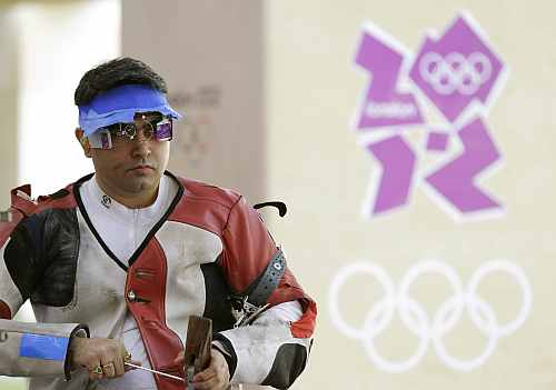India's Gagan Narang prepares to shoot, during qualifiers for the men's 50-meter rifle 3 positions, at the 2012 Summer Olympics