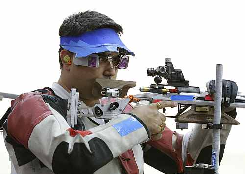 India's Gagan Narang prepares to shoot, during qualifiers for the men's 50-meter rifle 3 positions