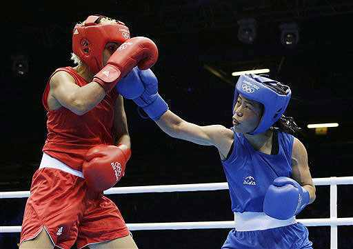 India's Mary Kom, right, fights Tunisia's Maroua Rahali during a women's flyweight 51-kg quarter-final boxing match