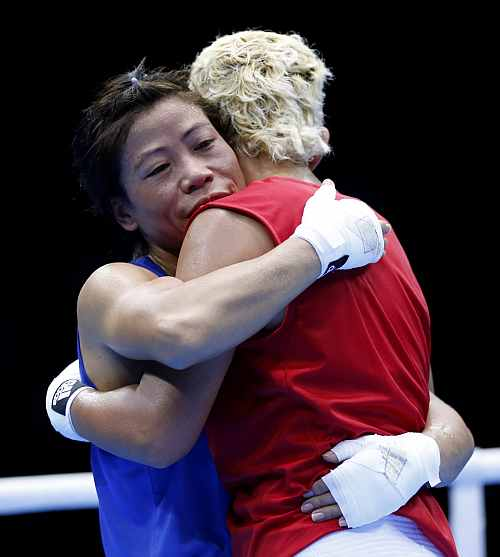 India's Mary Kom embraces Maroua Rahali of Tunisia after defeating her in their quarter-finals