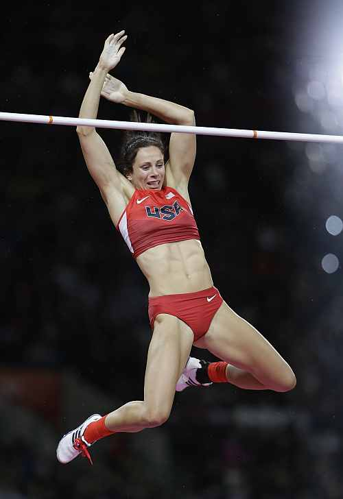 United States' Jennifer Suhr reacts as she clears the bar in the women's pole vault final