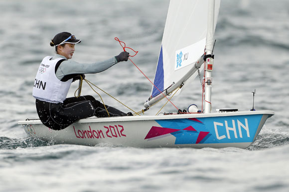 China's Xu Lijia sails during the ninth race of the Laser Radial sailing class
