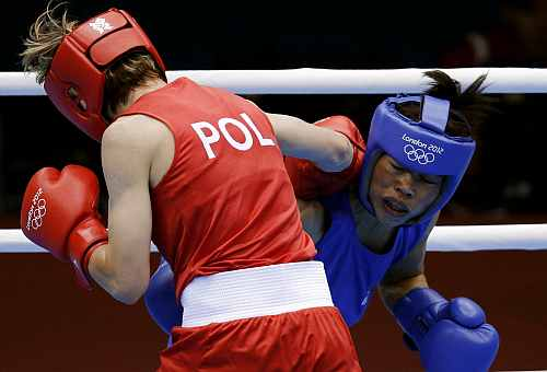 Poland's Karolina Michalczuk, fights India's Mary Kom during the women's flyweight boxing competition