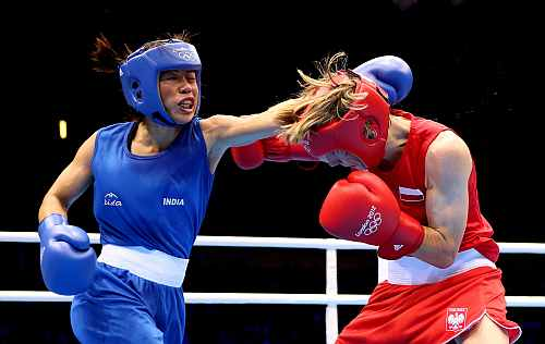 Mary Kom of India in action with Karolina Michalczuk of Poland during the Women's Fly (48-51kg) Boxing