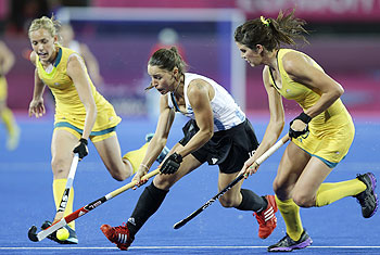 Argentina's Sofia Maccari (centre) runs with the ball, during a preliminary round women's hockey match against Australia at the Riverside Arena at the 2012 Summer Olympics on Monday